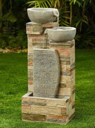Moderní zahradní fontána misky na zídce
